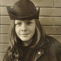 Adolescent Boy with Long Hair, Cowboy Hat, and Fringed Jacket